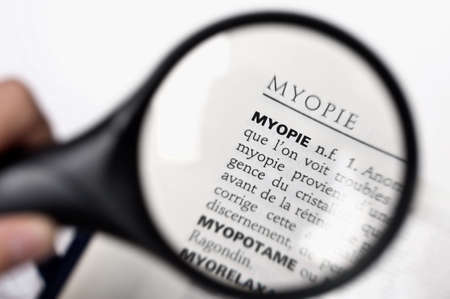 myopia: Magnifying glass on the word myopie (myopia) in a French dictionary