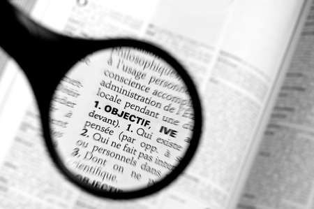 thesaurus: Magnifying glass on the word objectif (goal) in a French dictionary