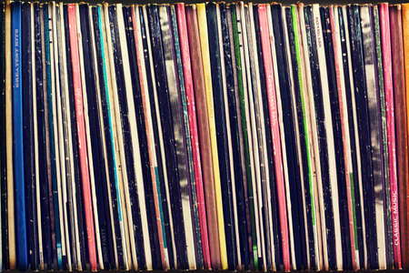 Collection of vinyl records covers (dummy titles) background, vintage process photo