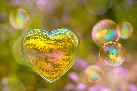 Soap bubble in the shape of a heart Stock Photo