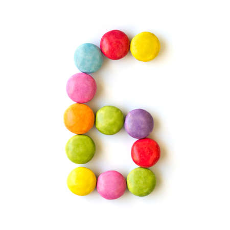 number 6: Colored candies number six isolated on white background Stock Photo