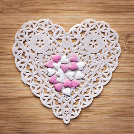 suger: Heart paper with suger hearts on wood