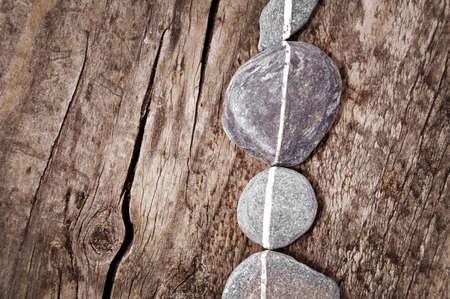 aligned: Stones aligned on wood Stock Photo