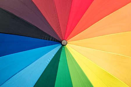 chromatic colour: Close-up of a rainbow colored umbrella Stock Photo