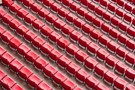 oudoor: Empty ranges of red seats in a stadium, astract aerial view from above Stock Photo