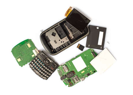 dismounted: Disassembled mobile phone parts on white background