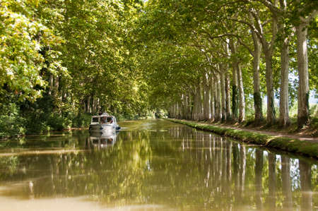 canals: Tourism boat on the Canal du Midi, Southern France Stock Photo