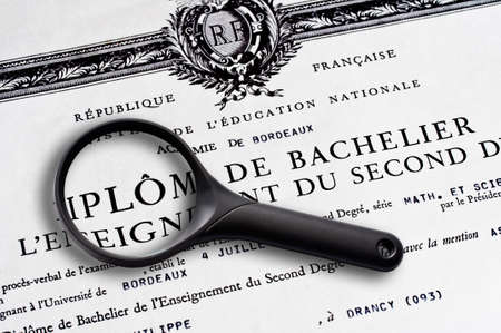 baccalaureate: French baccalaureate certificate and magnifying glass