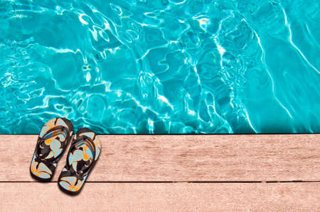 wooden shoes: Flip flops and swimming pool close-up