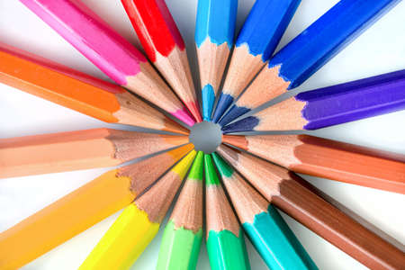 Colorful pencils in circle on white  photo