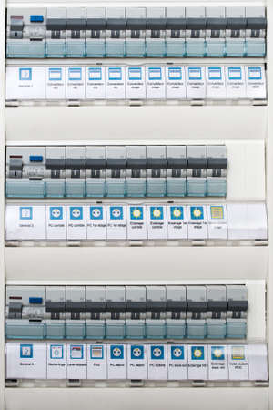 meter box: Close up of a modern home electrical panel with automatic fuses