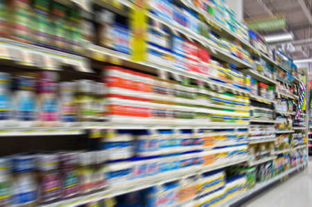 isle: Motion blurred background of unidentified products in a supermarket