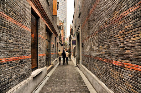 Narrow alley with brick walls, Xintiandi, Shanghai, China