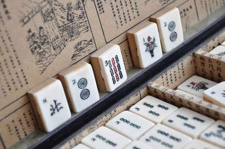 mahjong: Box of old Mahjong tiles Stock Photo