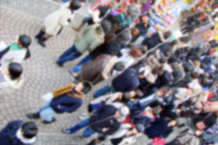 Blurred background of a crowd in the street view from above