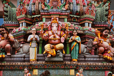 hindu gods: Statue of Ganesh and other hindu gods on a colorful indian temple facade Stock Photo