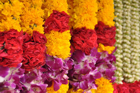 Indian colorful flower garlands in an hindu temple