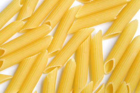 penne: Dry pasta penne background Stock Photo