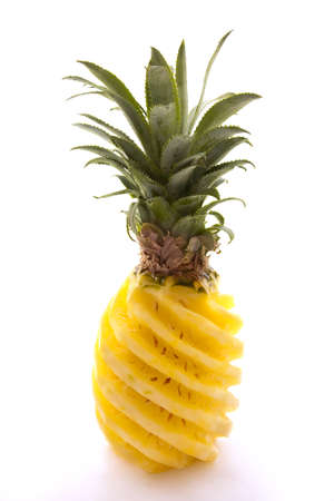 sculpted: Peeled and sculpted whole pineapple with its stalk on white background Stock Photo