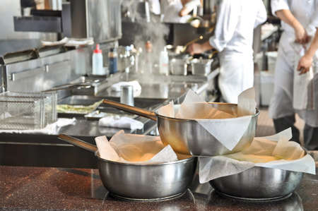 Pans in a restaurant kitchen Stock Photo