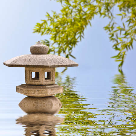 Japanese stone lantern and reflections Stock Photo