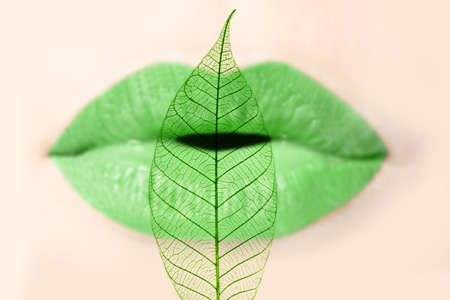kissing lips: Green lips and leaf Stock Photo