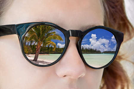 Beach reflections in a girl sunglasses Stock Photo