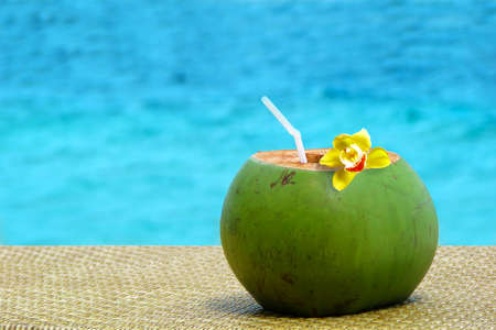 pool bars: Fresh coconut juice with a drinking straw by the swimming pool