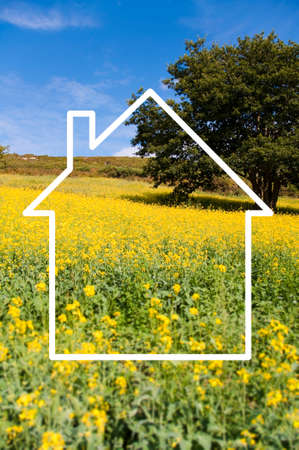 investment vision: Silhouette frame of a house, countryside landscape in the background