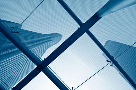 modern buildings: Looking up at business buildings through a glass roof