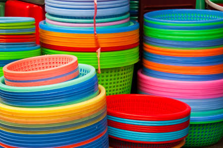 plastic to containers: Colorful rainbow, plastic containers on a marker Stock Photo
