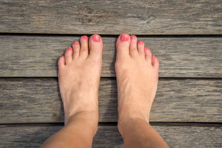 nude woman standing: Selfie of woman bare feet on wooden floor Stock Photo