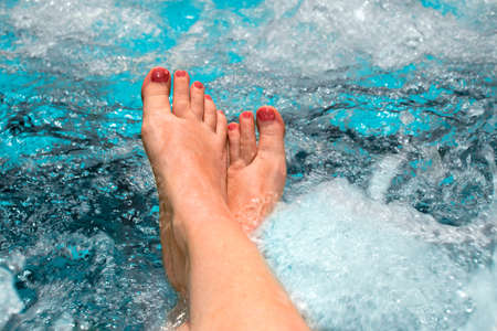 Feet of a woman relaxing in a jacuzzi