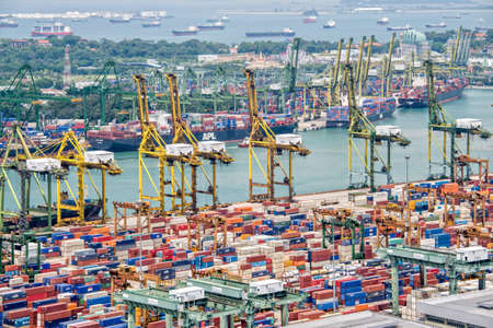 Aerial view of the port of Singapore the busiest asian commercial port with cargo ships and containers
