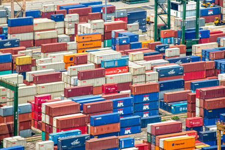commercial docks: Piles of containers in the harbor of Singapore the busiest asian commercial port Stock Photo