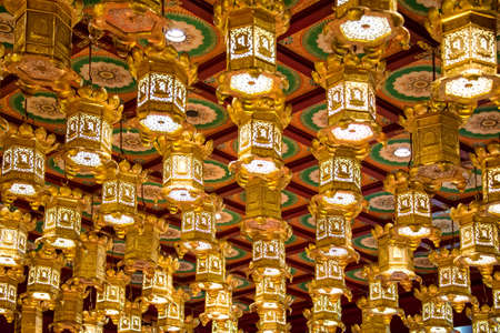 chinatown: Interior of the Buddha Tooth Relic Temple the most famous buddhist temple of Chinatown in Singapore Stock Photo