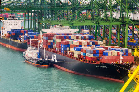 ships: Container ship in the port of Singapore the busiest asian commercial port with cargo ships and containers