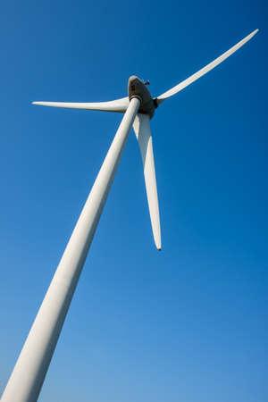 below: Close up of a wind turbine view from below