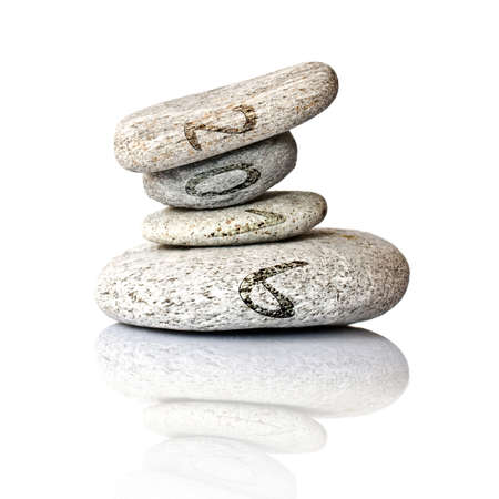 balanced rocks: 2016 written on stack of pebbles isolated on white background