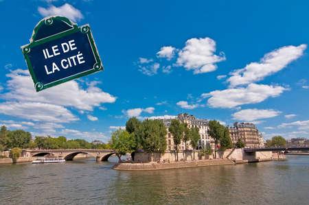 ile de la cite: Ile de la Cite on the river Seine in Paris with a street plate
