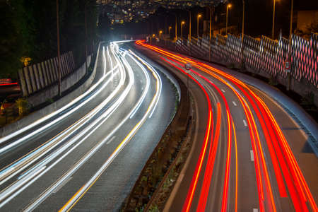 night highway: Light trails of cars on a highway Stock Photo