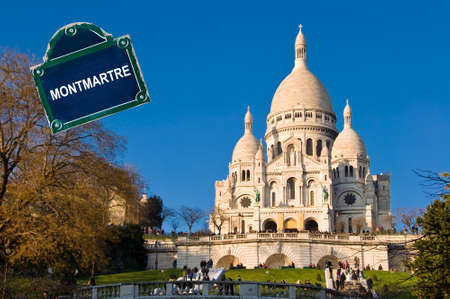 Sacre coeur basilica in Montmartre, Paris with a street plate photo