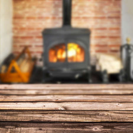 wood burning stove: Rustic planks, wood burning stove in the background
