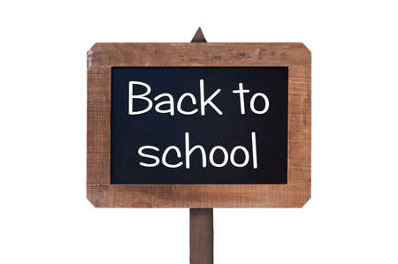 vintage sign: Back to school written on a vintage wooden chalk board sign isolated on white background Stock Photo
