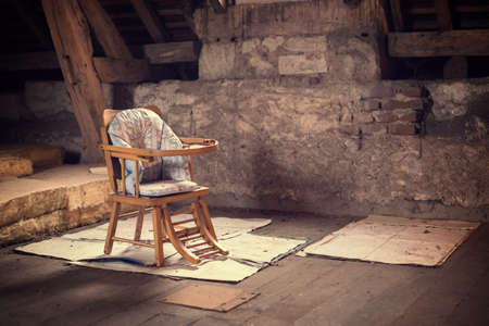 baby chair: Old vintage baby chair in a dusty attic
