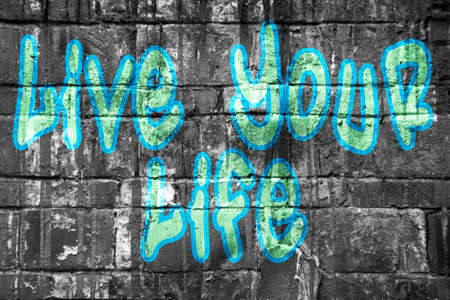 life style: Live your life tag style on wall, blue