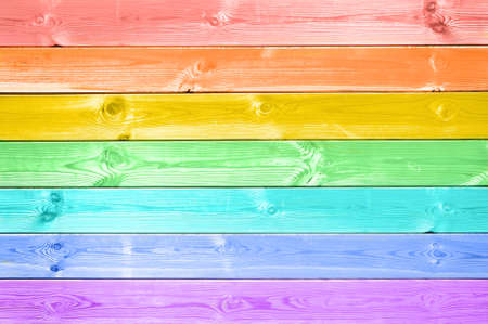 Pastel colorful rainbow painted wood planks background Stockfoto