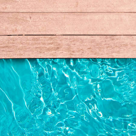 Wooden deck and swimming pool close up