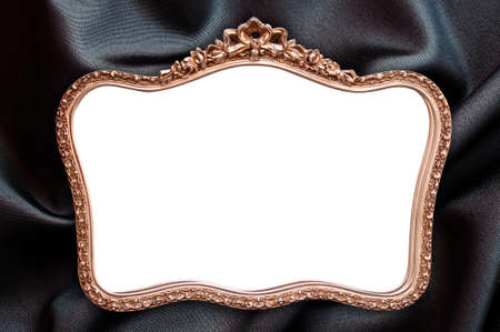 baroque picture frame: Antique frame with blank copy space, black fabric background Stock Photo
