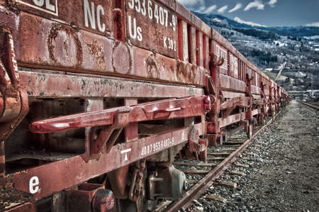 railway transportations: Rusty old freight wagon on a railway line Stock Photo